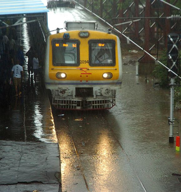 A Virar-bound local train at a flooded station