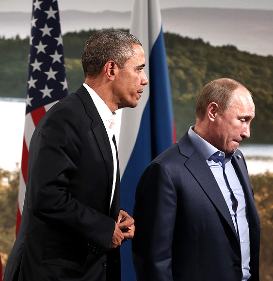 Obama and Putin walk away after their meeting during the G8 Summit