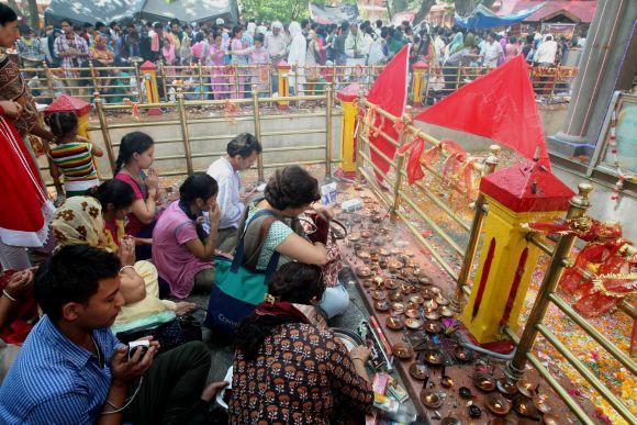 Kashmiri Pandits offer prayers at Khir Bhawani temple in Tullamulla