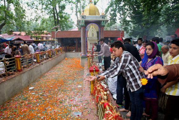 Kashmiri Pandits offer prayers at Khir Bhawani temple on Monday