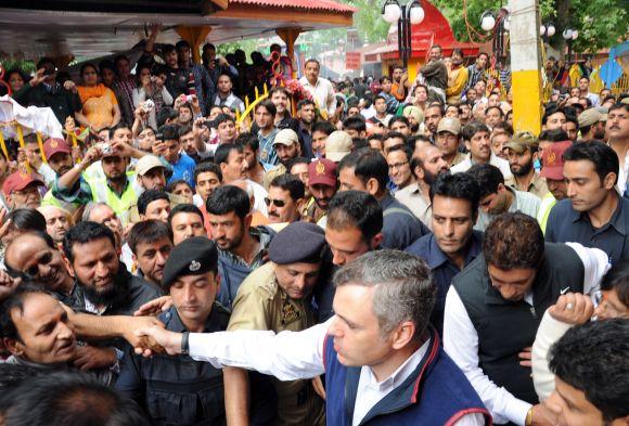 Jammu and Kashmir Chief Minister Omar Abdullah greets Kashmiri Pandits at Khir Bhawani temple