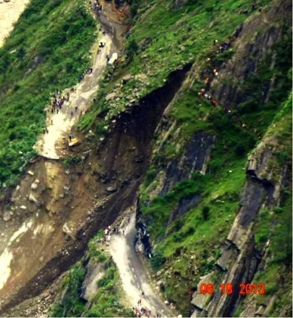 This image shows one of the many roads in Uttarakhand that were destroyed in the landslide. People can be seen taking a hike on the hills to reach the other end of the road