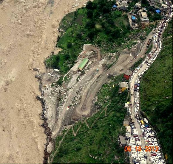 This image shows many vehicles stranded on a road in Uttarakhand following landslides