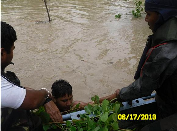 Army personnel conducting flood-relief operation in Uttarakhand