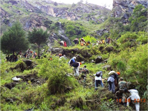 Army personnel rescuing stranded people in rain-ravaged Uttarakhand