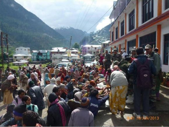 Food and water being provided to stranded people by army in rain-ravaged Harsil, Uttarakhand