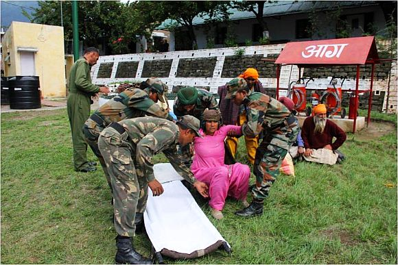 Injured people airlifted by the army being shifted to a hospital in Uttarakhand