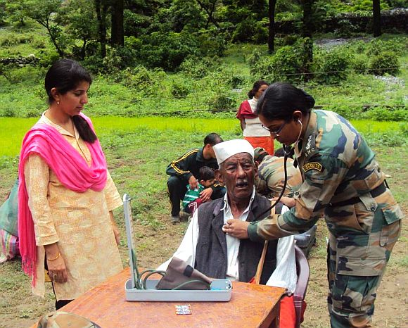 An elderly person being treated by an army doctor in Uttarakhand on Thursday