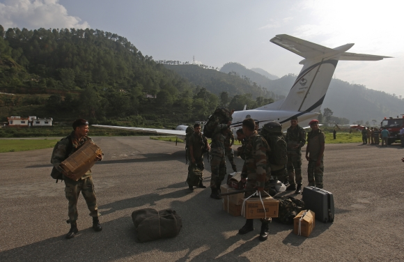 Indian Army paratroopers arrive to help in rescue operations at an airfield in Gauchar