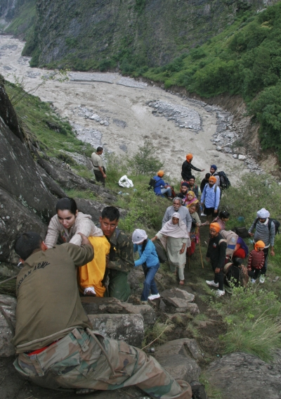 Soldiers rescue stranded people after heavy rains in Uttarakhand