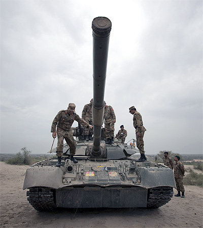 Top Pakistan Army officials climb atop a tank during military exercises in the Khudai Range in central Punjab's Muzaffargarh district