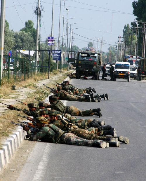 Army personnel talking positions after a militant strike on a convoy outside Srinagar on Monday