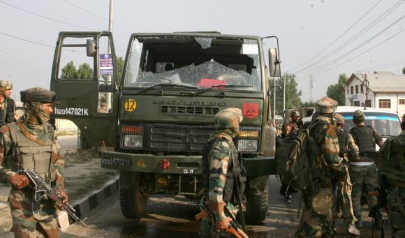 The broken windshield of the army truck that was attacked in amilitant strike outside Srinagar on Monday
