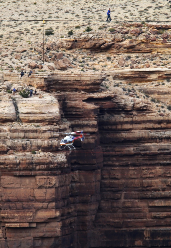 Daredevil Nik Wallenda walks on a two-inch diameter steel cable rigged across more than a quarter-mile deep remote section of the Grand Canyon near Little Colorado River, Arizona