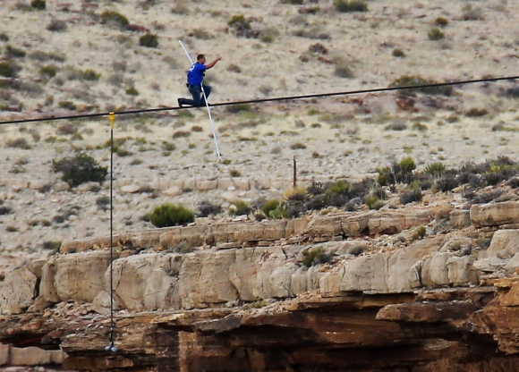Wallenda gives a thumbs-up sign as he nears the end, after walking across the Grand Canyon