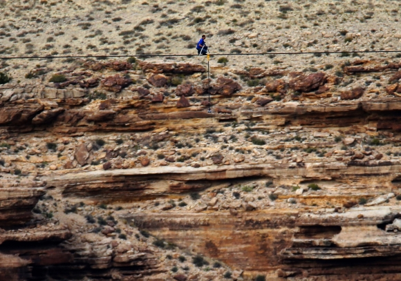 Wallenda pauses in the middle of his stunt across the canyon
