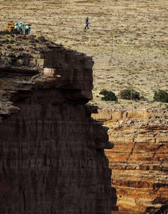 Wallenda balances himself as he walks the tightrope above Grand Canyon