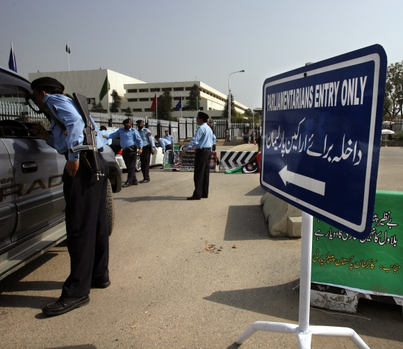 Policeman check vehicles entering the National Assembly in Islamabad Pakistan