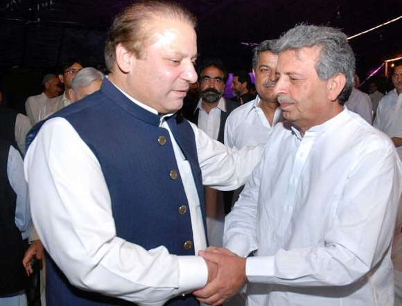 Federal minister Rana Tanveer Hussain (right) paid no taxes last year