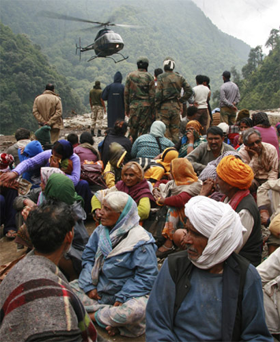 ITBP personnel rescue stranded people across a flooded river in Uttarakhand.