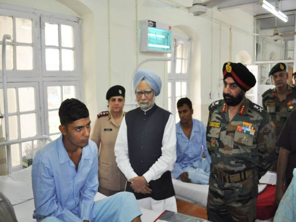 Dr Singh inquires wellbeing of an injured jawan in Srinagar on Tuesday