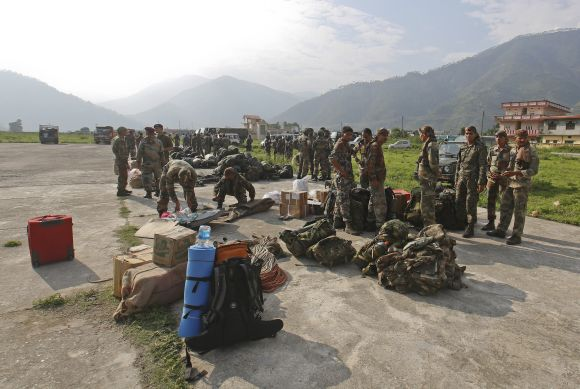 Indian Army Paratroopers prepare to leave for rescue operations at an airfield in Gauchar in Uttarakhand