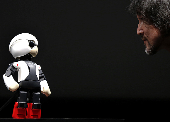 Kirobo talks to Fuminori Kataoka, project general manager in the Product Planning Group of Toyota Motor Corp, during its unveiling in Tokyo