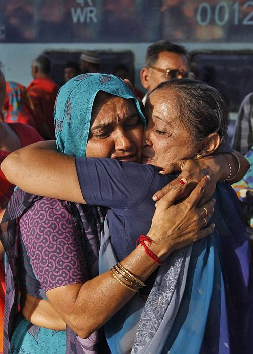 A pilgrim who was stranded in Uttarakhand reacts after meeting her relative