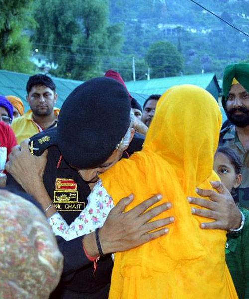 A survivor shows her gratitude to the men in uniform in Uttarakhand