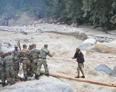 Soldiers rescue a tourist stranded in flood-hit Uttarakhand