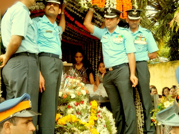 Wing Commander Daryl Castelino's wife Jyothi accompanies her late husband's coffin.