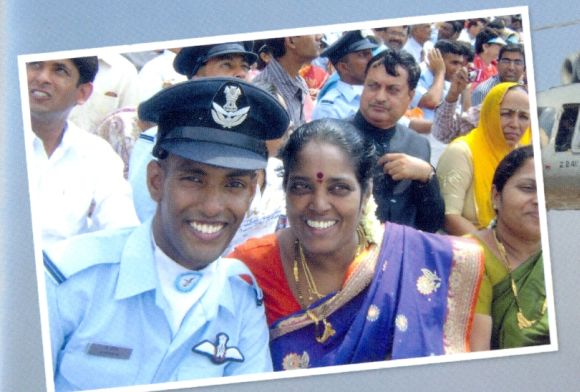 A photograph of K Praveen with his mother, from the family album
