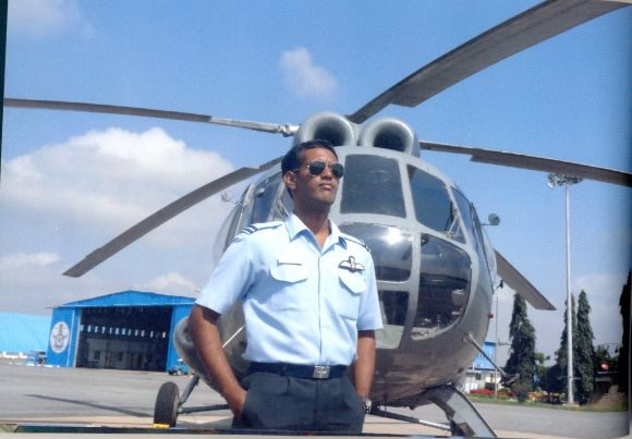 A photograph of K Praveen with his helicopter, from the family album
