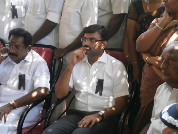 Tamil Nadu Minister for Cooperation Sellur K Raju and the outgoing collector of Madurai, Anshul Mishra, at K Praveen's funeral