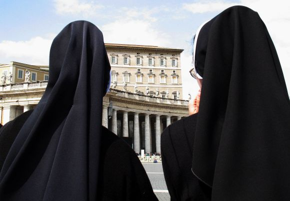 Nuns look towards the Apostolic Palace in Saint Peter's Square