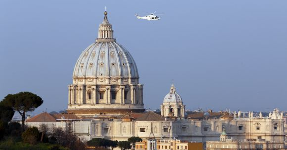 A helicopter carrying Pope Benedict XVI takes off from inside the Vatican on its way to the papal summer residence at Castelgandolfo