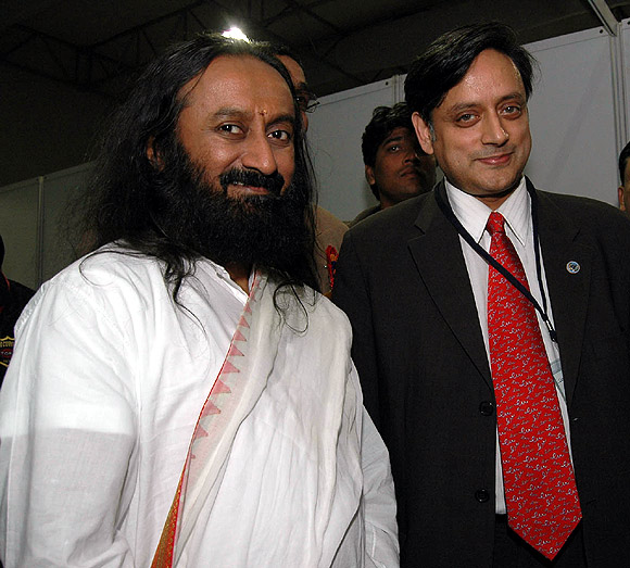 Corruption is one of the biggest ills that ails India, says Sri Sri Ravi Shankar, seen here with Union Minister of State for Human Resource Development Shashi Tharoor.