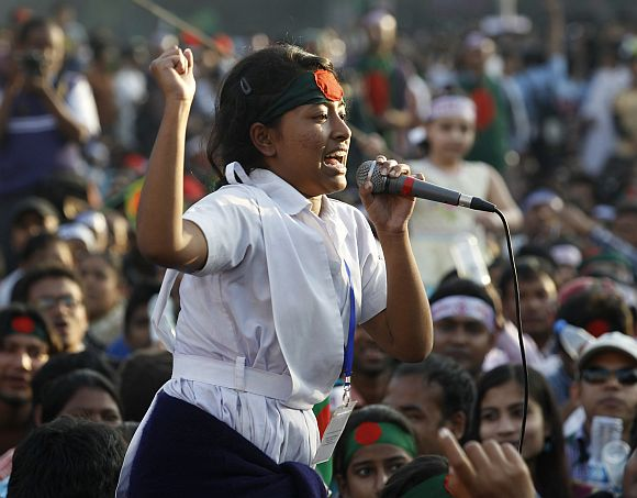 A student of the Holy Cross Girls' College shouts slogans as she attends a mass demonstration at Shahbagh intersection, demanding capital punishment for Bangladesh's Jamaat-e-Islami senior leader Abdul Quader Mollah, after a war crimes tribunal sentenced him to life imprisonment, in Dhaka