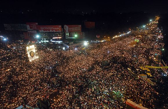 People attend a mass candlelight vigil as they demand the execution of all war criminals, including Jamaat leader Abdul Quader Mollah, at Shahbagh intersection in Dhaka