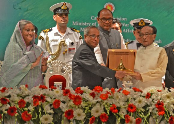 President Pranab Mukherjee receives 'Bangladesh Muktijuddho Sanmanona' award from his counterpart Zillur Rahman in the presence of PM Shekh Hasina in Dhaka on Monday
