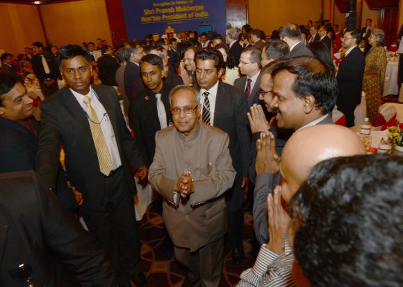 President Pranab Mukherjee is greeted by dignitaries during a function in Dhaka on Monday