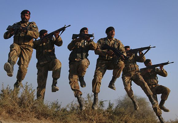 Pakistani soldiers participate in a military exercises in the Cholistan desert, near the India-Pakistan border.