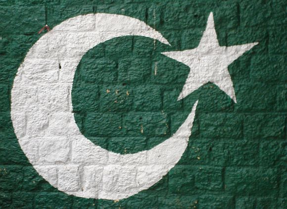 The Pakistani flag painted on a wall in Islamabad.