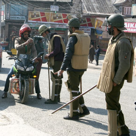 Security personnel seen stopping vehicles to seek details as curfew continued in parts of Srinagar on Wednesday