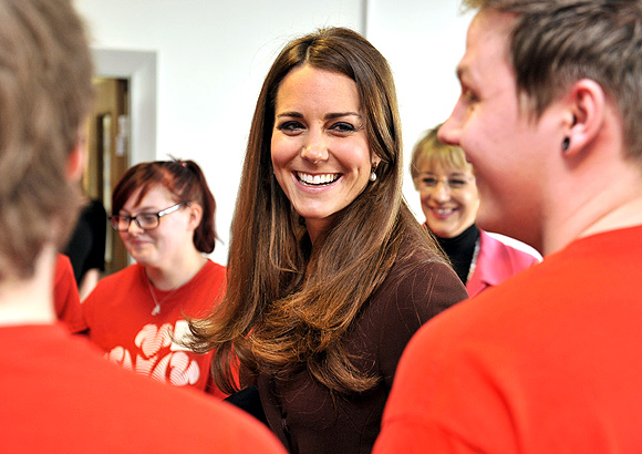 Britain's Catherine, Duchess of Cambridge speaks with unemployed young people who