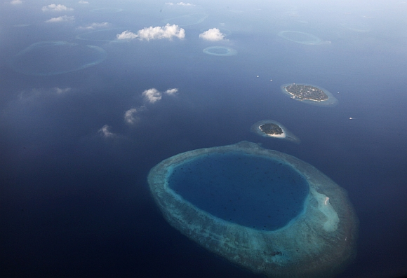 An aerial view shows an atoll in the Maldives. There are over 1,100 islands which are dispersed in the open sea, and sparsely populated