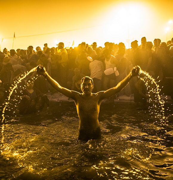 Devotees bathe in the waters of the holy Ganga