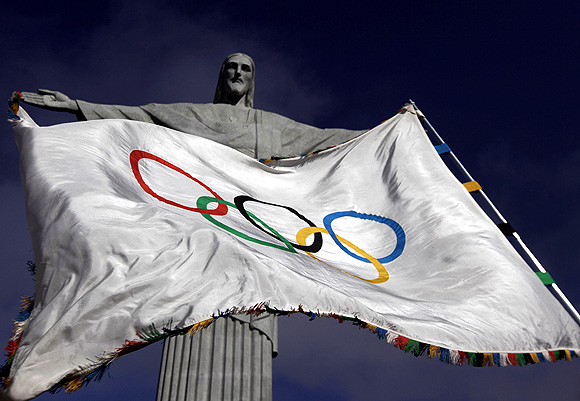 The Olympic Flag flies in front of 'Christ the Redeemer' statue during a blessing ceremony in Rio de Janeiro, where the next games will be hosted in 2016