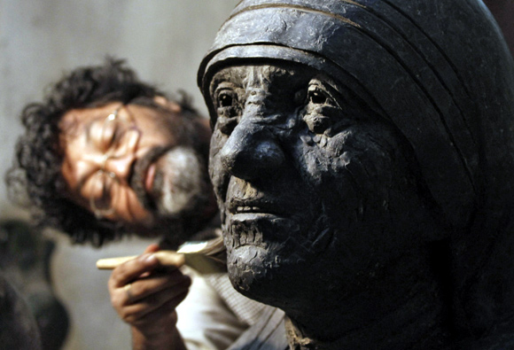 An artisan works on a statue of Mother Teresa in Kolkata
