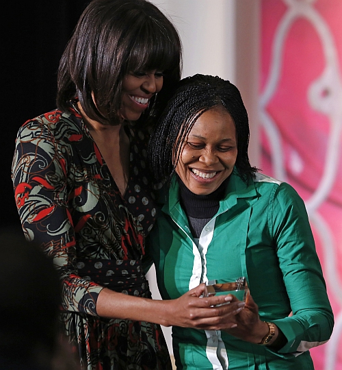 Michelle Obama stands with Josephine Odumakin of Nigeria as Odumakin receives the International Women of Courage Award at the state department in Washington